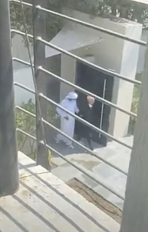 People can be seen gathering in the courtyard of the private villa, where she has been living with her three daughters; Sana, four; Asiya, three and Salama, one